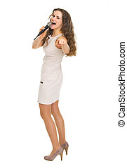 Full length portrait of happy young woman with microphone
