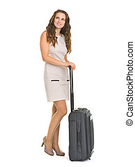 Full length portrait of happy young woman with wheels suitcase