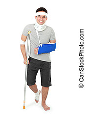 injured young man on crutch - full length portrait of...