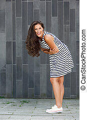 laughing young woman in striped dress