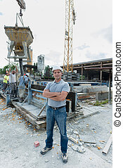 full length portrait of male worker construction site