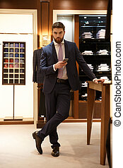 Full length portrait of man holding smartphone