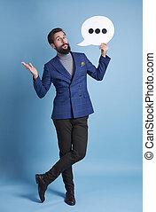 Full length portrait of man with speech bubble posing