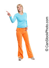 Full length portrait of middle age woman pointing in corner
