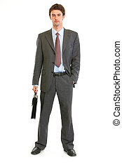 Full length portrait of modern businessman with briefcase