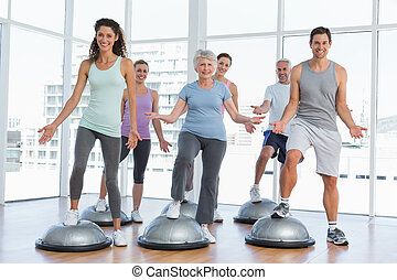 Full length portrait of people doing power fitness exercise