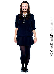Full length portrait of pretty girl in school uniform...