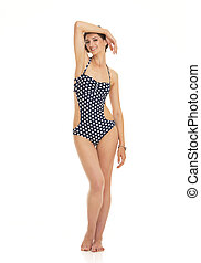 Full length portrait of relaxed young woman in swimsuit