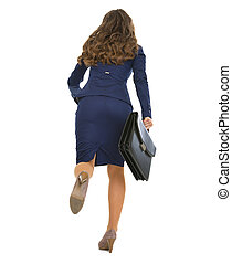 Full length portrait of running business woman with briefcase . rear view