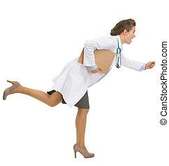 Full length portrait of running medical doctor woman