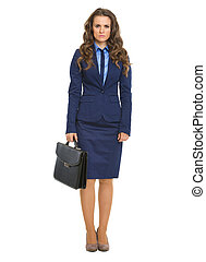 Full length portrait of serious business woman with briefcase