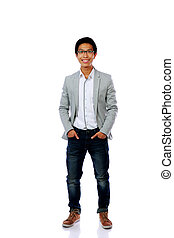 Full length portrait of smiling asian man isolated on a white background