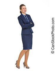 Full length portrait of smiling business woman looking on copy space