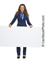 Full length portrait of smiling business woman showing blank billboard