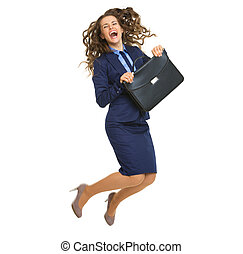 Full length portrait of smiling business woman with briefcase jumping