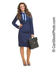 Full length portrait of smiling business woman with briefcase