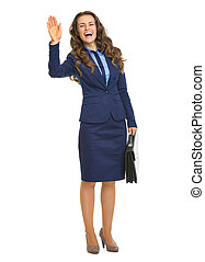 Full length portrait of smiling business woman with briefcase welcoming