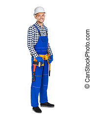 Full length portrait of smiling construction worker in uniform and tool belt
