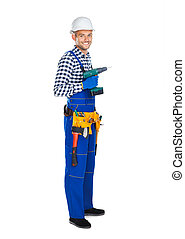 Full length portrait of smiling construction worker with drill