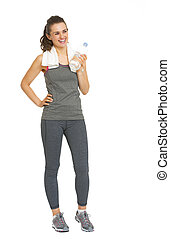 Full length portrait of smiling fitness young woman with bottle of water