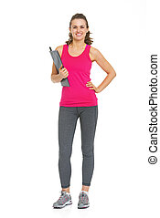 Full length portrait of smiling fitness young woman with clipboard