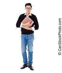 Full length portrait of  smiling school boy holding books