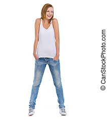 Full length portrait of smiling teenage girl looking on copy space