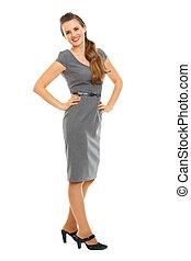 Full length portrait of smiling woman in dress
