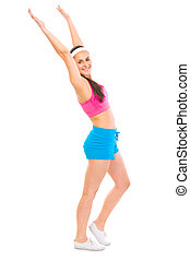 Full length portrait of smiling woman in sportswear making exercise