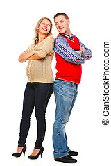 Full length portrait of smiling young pregnant with husband isolated on white