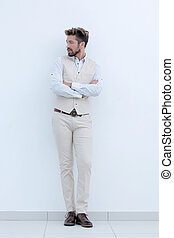 Full length portrait of stylish man with crossed hands