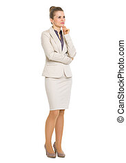 Full length portrait of thoughtful business woman looking on copy space