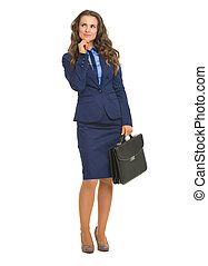 Full length portrait of thoughtful business woman with briefcase
