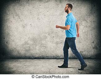 full length portrait of walking bearded man