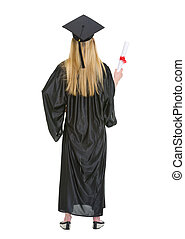 Full length portrait of woman in graduation gown showing diploma . rear view