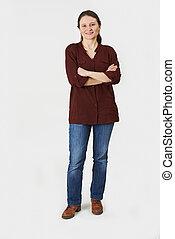 Full Length Portrait Of Woman Standing In Studio On White Backgr