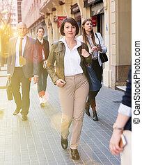 Full-length portrait of woman walking on street