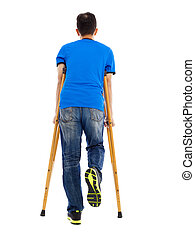full length portrait  of  Young asian man on crutches