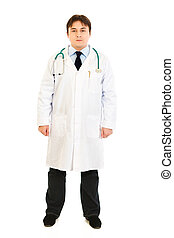 Full length portrait of young medical doctor in uniform with stethoscope isolated on white