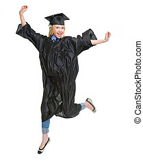 Full length portrait of young woman in graduation gown jumping