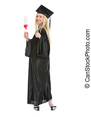 Full length portrait of young woman in graduation gown showing diploma and thumbs up