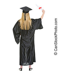Full length portrait of young woman in graduation gown with diploma . rear view