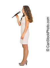 Full length portrait of young woman with microphone
