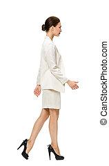 Full length portrait profile of walking business woman