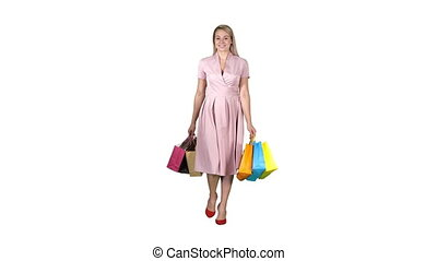 Shopping woman holding shopping walking to the camera on white background.