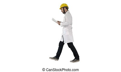 Engineer manager walking with hard hat is holding paper and checking on white background.