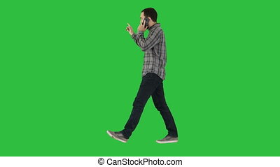 Man talking on phone, walking and making gestures on a Green Screen, Chroma Key.