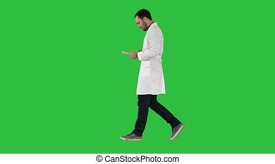 Medical care and healthcare Doctor use tablet checking on a Green Screen, Chroma Key.