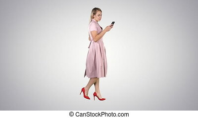 Pretty blonde woman using cell phone texting message on...