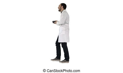 Walking attractive laughing doctor on white background. -...